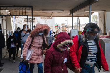 Migrants in MPP cross the Paso del Norte International Bridge from Ciudad Juárez to El Paso on Feb. 26, 2021.