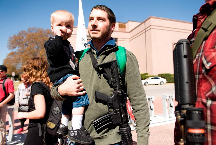 Chris Way and his son Ryan, 2, participate in an open carry march on March 12, 2014 during the South by Southwest festival. …