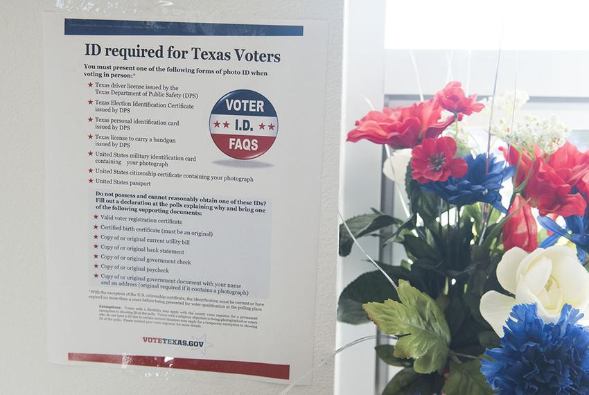 Voter ID regulations posted at a south Texas early voting location on Oct. 26, 2016.