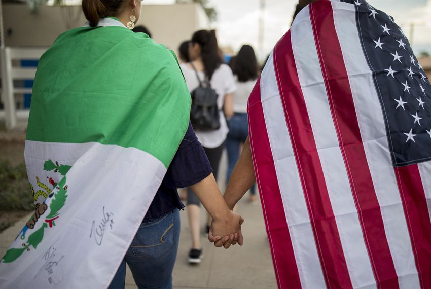 Samantha Ordaz and César Antonio Pacheco walked in a silent march Sunday for the victims of the mass shooting in El Paso the day before.