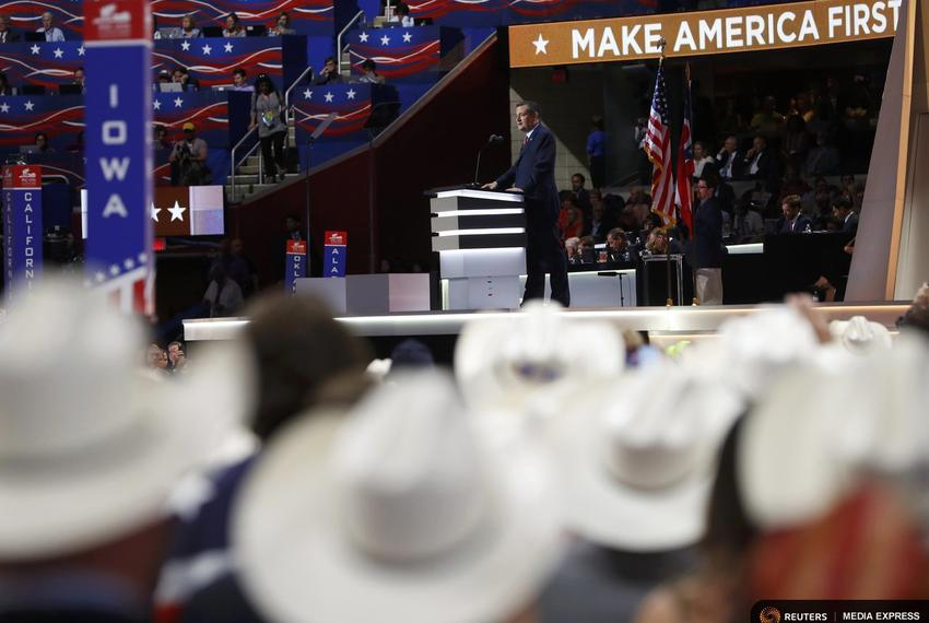 Former Republican U.S. presidential candidate Cruz speaks as the Texas delegation looks on during the third night of the Rep…