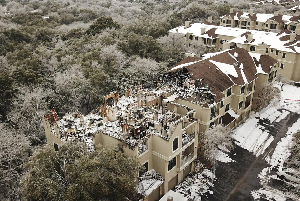 Aerial view of fire damage at an apartment building at The Park on Brodie Lane. Feb. 18, 2021.