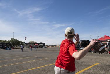 Charlie McBride throws a football before Texas Tech's home coming game against West Virginia at Texas Tech University on Saturday in Lubbock. Oct. 24, 2020.