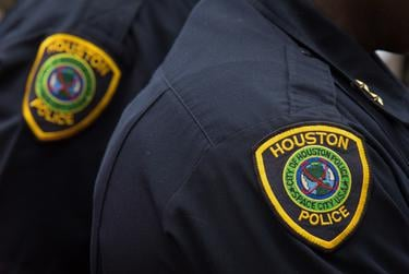Houston police officers and SWAT team members on the scene in a west Houston neighborhood where a gunman with an assault rifle shot one man and injured 6 before being killed by a SWAT officer on May 29, 2016.