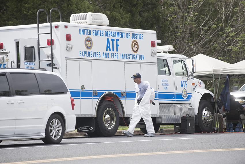 ATF and FBI agents work into the afternoon on Monday, March 19, after a fourth package bomb exploded Sunday night on a southwest Austin roadside.