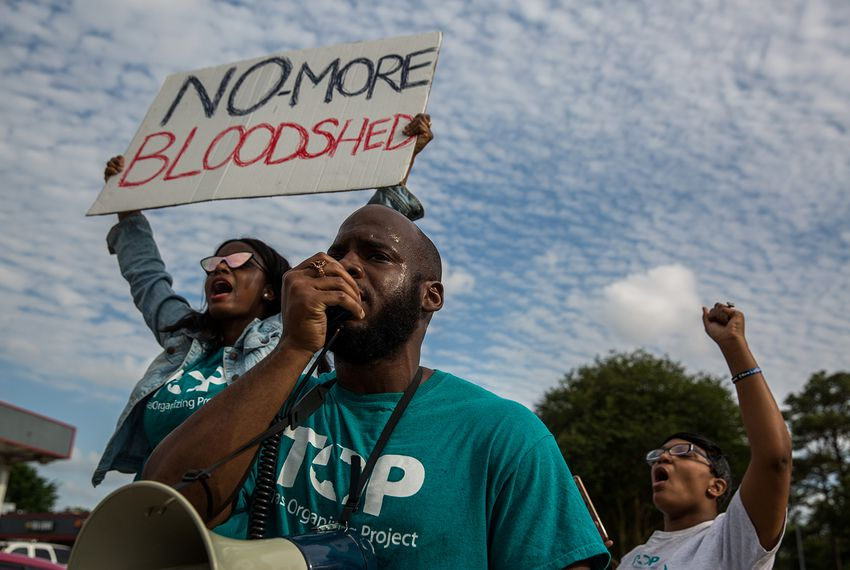 The Texas Organizing Project calls attention to a town hall meeting in north Houston at the intersection where Danny Ray Thomas, an unarmed black man, was shot by a Harris County Sheriff's deputy in March 2018.