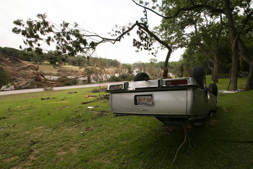 An overturned vehicle on the banks of the Blanco River on May 26, 2015. The area saw record-breaking flood levels two days before.