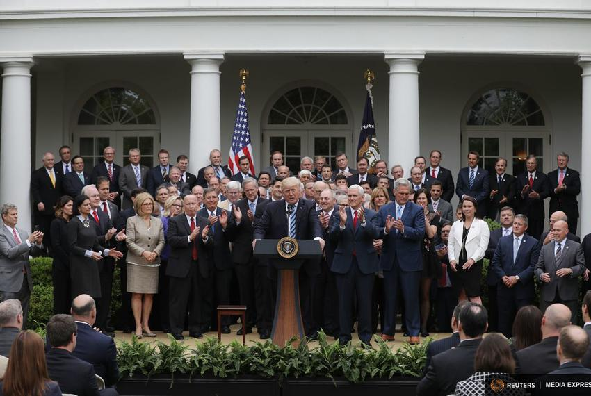 President Donald Trump gathers with congressional Republicans in the Rose Garden of the White House after the U.S. House o...