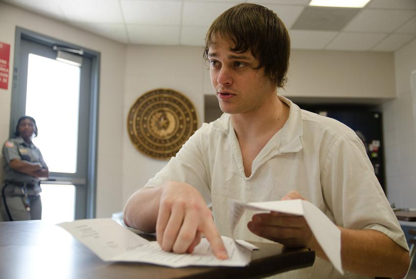 Roddy Pippin, a severely diabetic prisoner who is serving time for cattle rustling, points to court documents he has filed c…