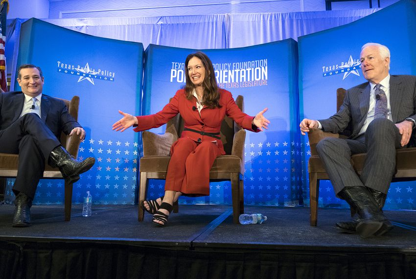 Brooke Rollins, president and CEO of the Texas Public Policy Foundation, comments on Sen. Ted Cruz's, left, and Sen. John Cornyn's black boots during a TPPF conference in January 2017 in Austin.