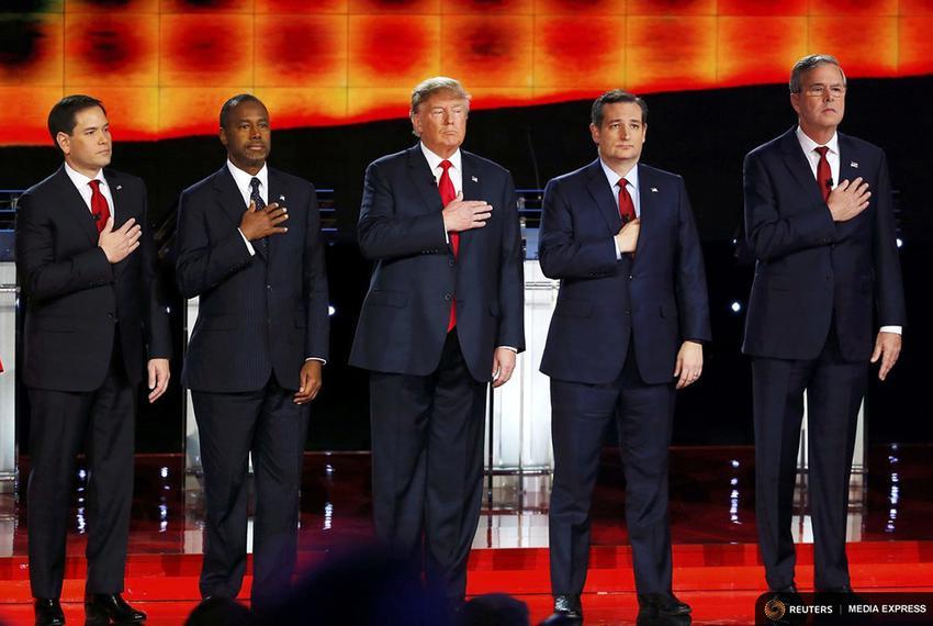 GOP presidential hopefuls (l-r) Marco Rubio, Ben Carson, Donald Trump, Ted Cruz and Jeb Bush pledge allegiance at the CNN de…