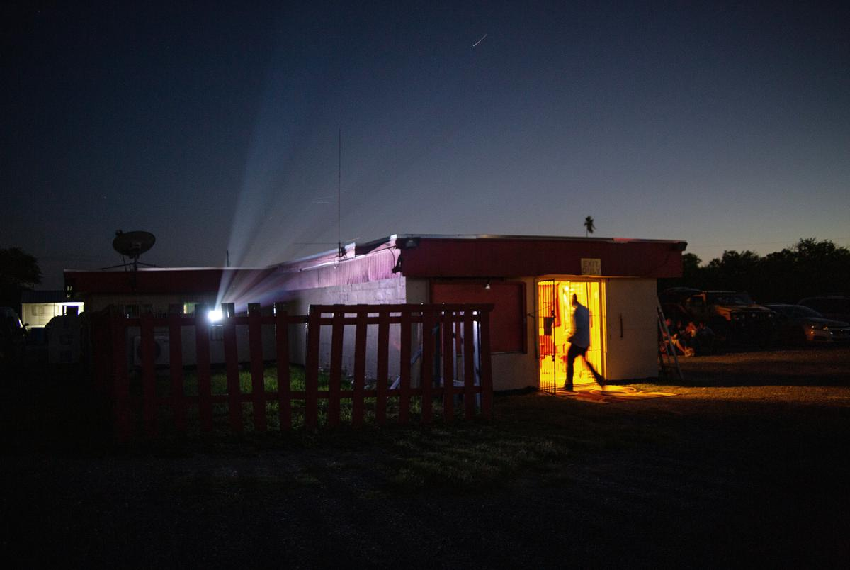 A man walks into the concessions stand at the WesMer Drive-In Theatre in Mercedes on June 11, 2021.