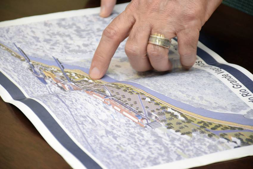 Laredo Mayor Pete Saenz shows on a map where the city's River Vega project will be built should his administration secure ...