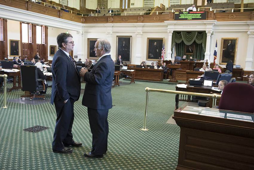 Sen. Charles Perry, R-Lubbock, chats with Sen. Kirk Watson, D-Austin, during presentation of a substitute floor amendment ...