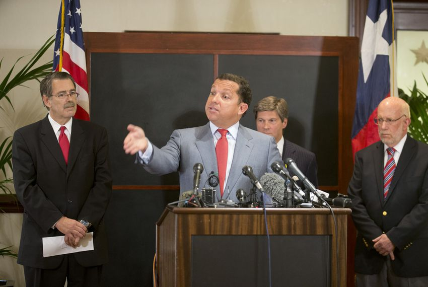 Gov. Rick Perry's legal team, led by Houston attorney Tony Buzbee, c, speaks to the press on August 18, 2014.