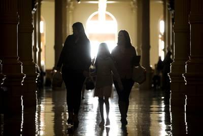 Left to right: Beatriz Ozuna, Bella Maldonado and Klaudia Nevarez walk into the state Capitol on the first day of the 86th legislative session.