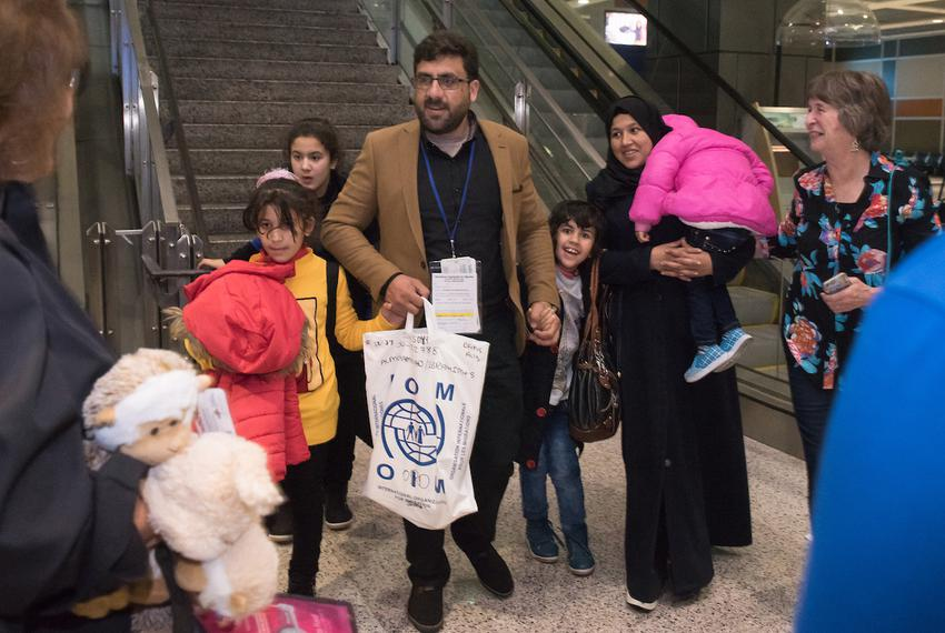 The Almohammad family, a refugee family from Syria, arrives at Austin-Bergstrom International Airport late at night on Feb. …