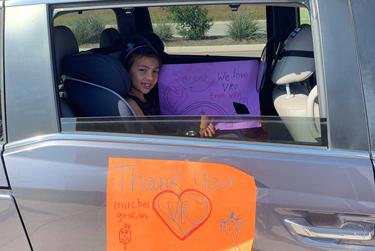 Nina Shah, 6, visited Vineyard Ranch Elementary School with her mother and thanked teachers and staff with a hand-drawn sign.