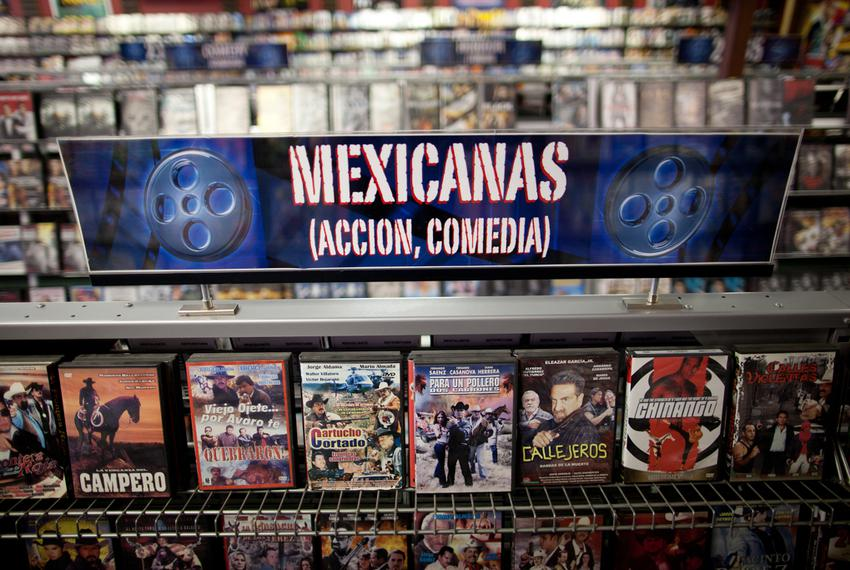 Low-budget movies about narcos, or Mexican drug dealers, are displayed on a shelf in Video Mexico, a video rental store in A…