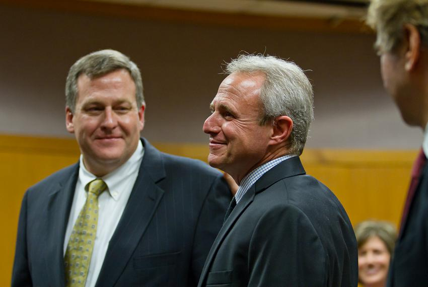 Michael Morton stands in a Williamson County courtroom with his attorneys after murder charges against him were officially d…