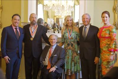John Paul DeJoria poses with Gov. Greg Abbott in February 2017. He was recognized for his corporate contributions to the arts in Texas.