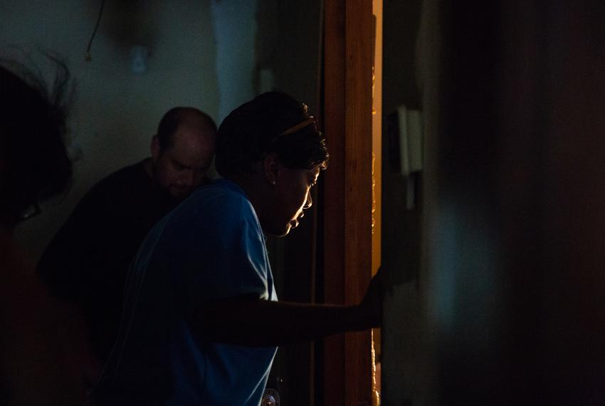 Charla Gilliam, specialist at Adult Protective Services, peers at her client through the doorway during a in-home visit of o…