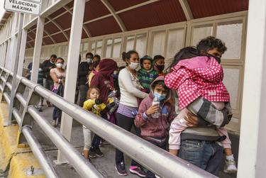 Migrants from Central America that were apprehended crossing the Rio Grande in Brownsville were flown to El Paso for processing and then deported to Mexico across the Paso del Norte International Bridge on March 16, 2021.