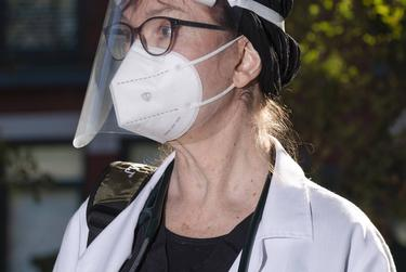 Medical doctor Sandra Petersen wearing some of her personal protective equipment before seeing COVID-19 patients inside The Forum at Park Lane Assisted Living facility in Dallas, on Thursday, Dec. 10, 2020. Ben Torres for the Texas Tribune