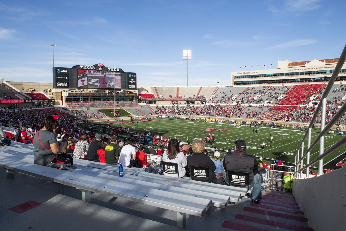 Fans watched Texas Tech's home coming game against West Virginia at Texas Tech University on Saturday in Lubbock, Texas. Texas Tech Athletics has reduced attendance to 25% of the general seating capacity of Jones AT&T Stadium.