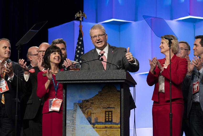 James Dickey stands with supporters at the Republican Party of Texas convention in San Antonio after being re-elected part...