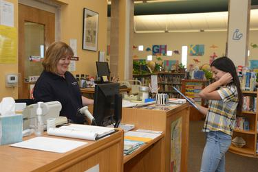 Carmen Elguezabel is the director of Presidio's public library, where people often come for all kinds of assistance, from applying for government benefits to renewing special equipment tags.