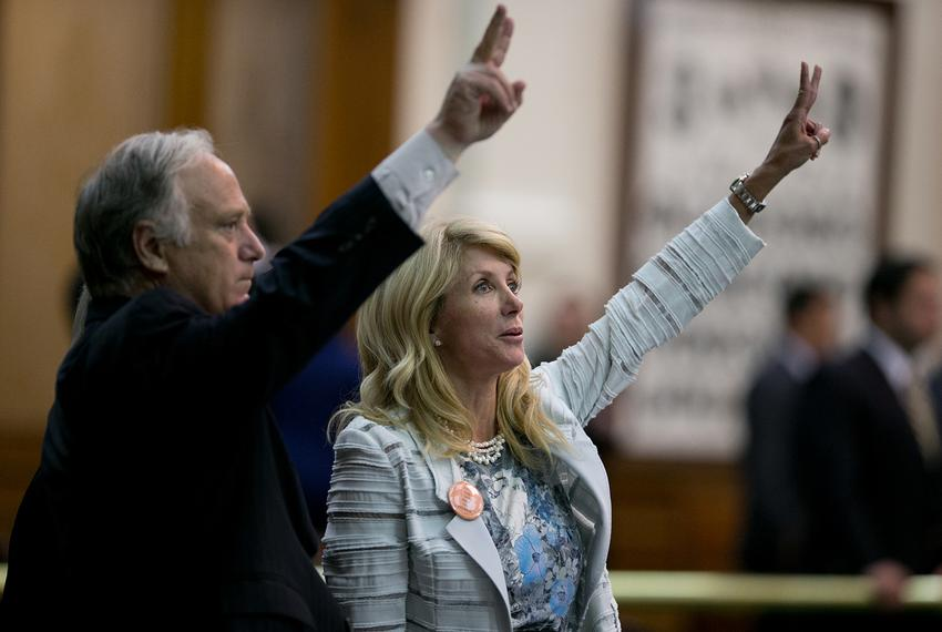 State Sens. Kirk Watson and Wendy Davis, late in the evening of Davis' filibuster five years ago, on June 25, 2013. Davis te…