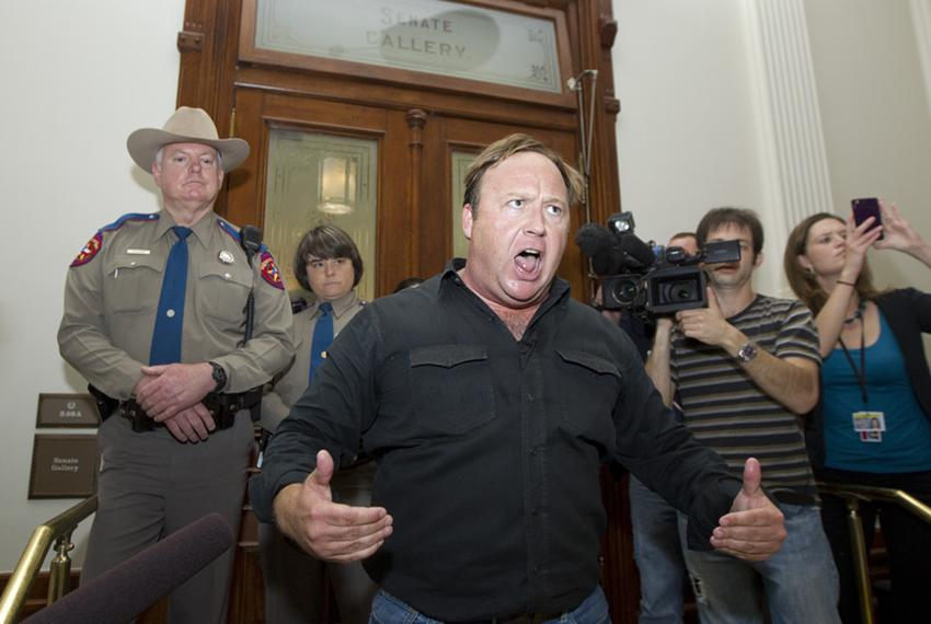 Talk show host and activist Alex Jones screams to the crowd outside the Senate gallery on May 25, 2011, after being denied e…
