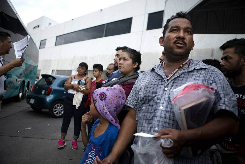 A group of migrants are processed at an immigration checkpoint in Nuevo Laredo. The group requested asylum in the United S...