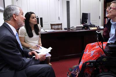 Nelda Hunter, chief of staff for state Rep. John Zerwas, R-Richmond, meets with Susie Angel (right) and Dennis Borel (left) to discuss personal attendant wages.