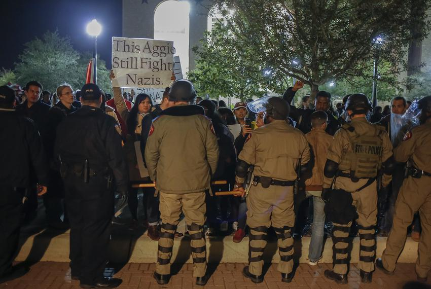 State Troopers in riot gear push protesters away from the building where white nationalist Richard Spencer was speaking at...