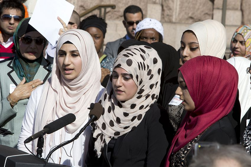 Over shouts of protesters, school kids led the gathering in the Pledge of Allegiance during Texas Muslim Capitol Day on Jan. 29, 2015.