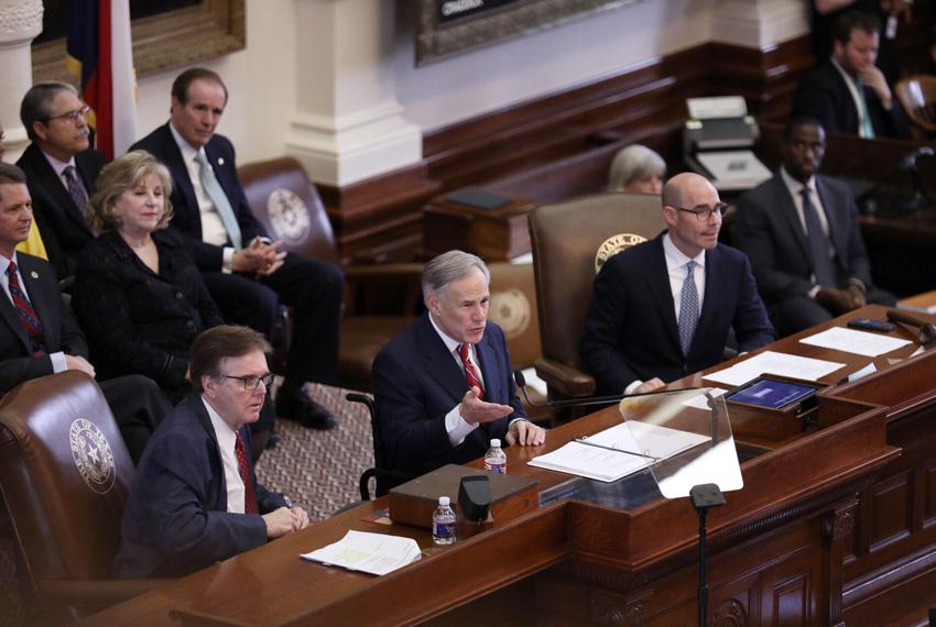 Flanked by Lt. Gov. Dan Patrick (left) and House Speaker Dennis Bonnen, Gov. Greg Abbott addresses members of the Texas le...