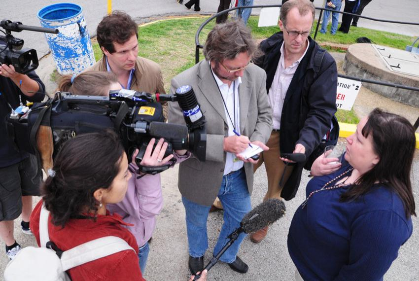 International media gather around death penalty abolitionist Kiersten Saldano shortly after the Supreme Court announced a ...