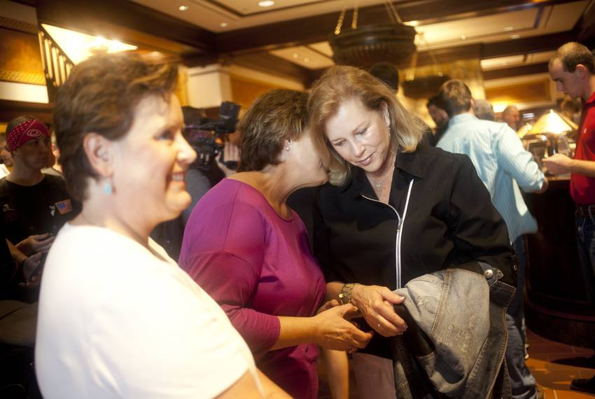 Anita Perry meets with supporters following her husband's talk at Hotel Pattee in Perry, Iowa.