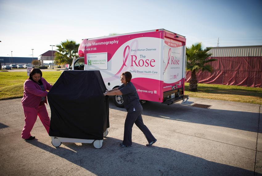 Donna Fehl, right, and Lilia Avila, left, of the Rose unload and set up a mobile mammogram machine at a clinic in Port Art...