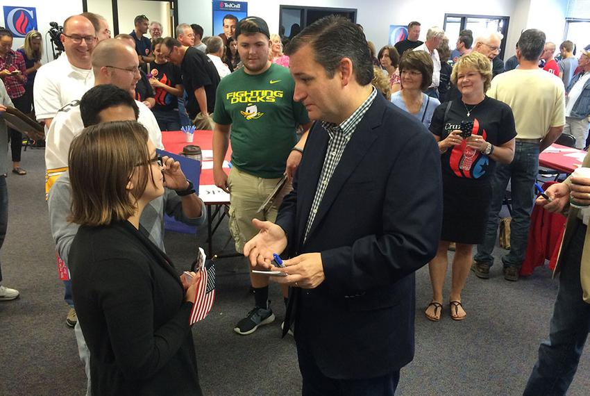 Presidential contender and U.S. Sen. Ted Cruz speaks with a supporter at the opening of his first Iowa office in Urbandale, …