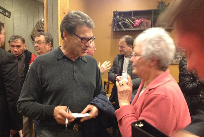 Former Texas Governor Rick Perry campaigns at a Pizza Ranch in Indianola, Iowa.
