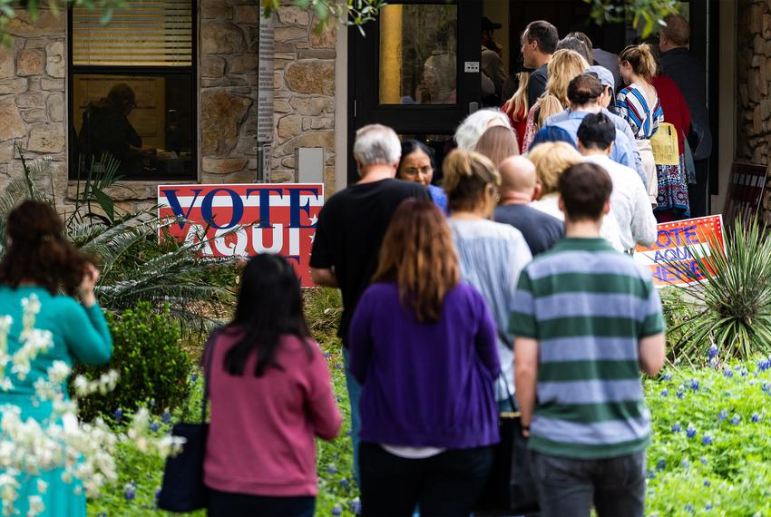 A line forms outside the Rollingwood City Hall during Super Tuesday voting on March 3, 2020. Due to a lack of volunteers, th…