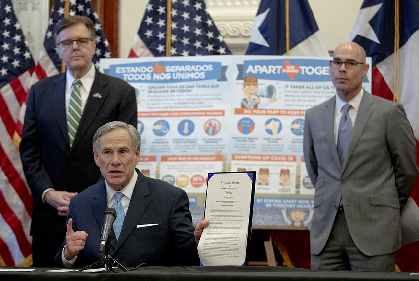 Gov. Greg Abbott, flanked by Lt. Gov. Dan Patrick, left, and House Speaker Dennis Bonnen, speaks during a press conference...