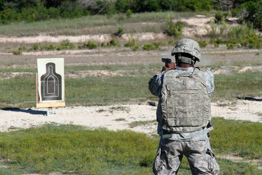 A soldier fires an M9 in a training exercise at Fort Hood Army base.