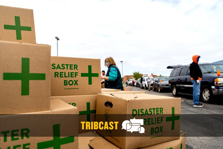 At the Waco ISD Stadium, volunteers from the Central Texas Food Bank load boxes of food into cars. Thousands of people waite…