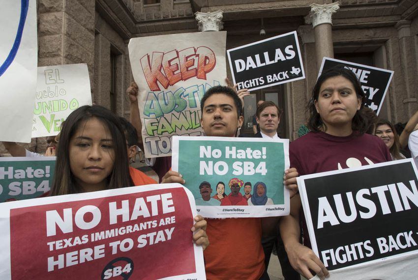 "Protesters against Senate Bill 4, known as the ""sanctuary cities"" bill, hold a noon rally at the Texas Capitol on May 16, 2017. Organizers say they're planning a ""summer of resistance"" against the measure."