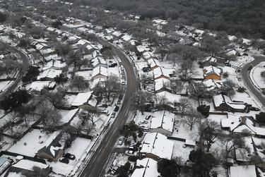 An aerial view of Austin after a severe snowstorm dumped heavy snow and plummeted temperatures. Feb. 17, 2021.