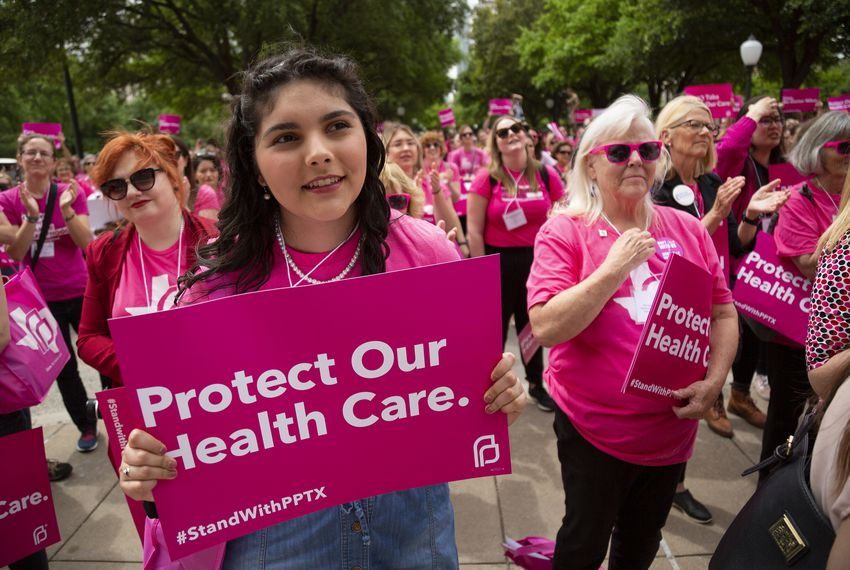 Planned Parenthood advocates rallied outside of the Capitol in April. A bill meant to prevent tax money from going to abortion providers has some health care advocates worried that other health programs may be cut.